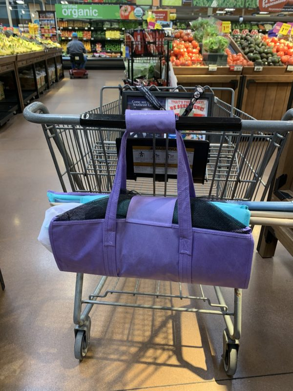 Lotus Trolley Bag hanging from grocery shopping cart